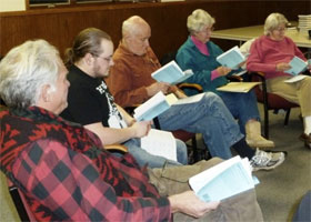 Pictured above, some of the cast of Arsenic and Old Lace during a first read-through of the play. From left, Jens Hansen, Jim Sorensen, Bob Wagner, Charlotte Manning, and Joan Blair. Photo courtesy of Mary Marik.