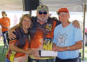 L-R: Becky McIntosh; Tom McIntosh, Chief Cook, T-Mac Smokin', Grand Champions; and Dick Jepsen, Chairman, Death's Door BBQ. Photo ©2015 Matt Weigand